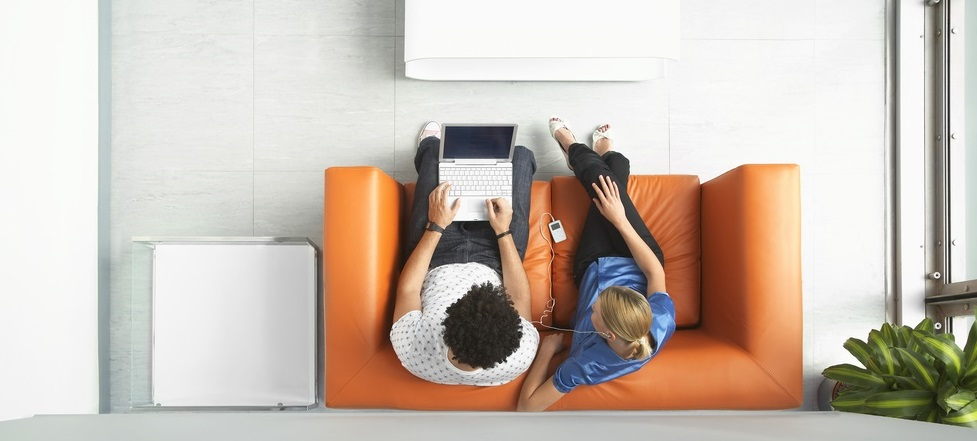 People sitting on a sofa having a meeting